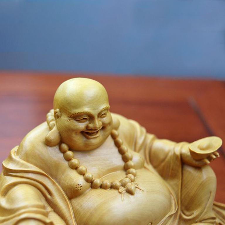 Tượng Phật Di Lặc để xe ô tô giúp đem lại may mắn, bình an khi lái xe
