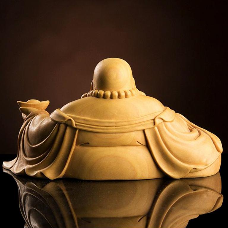 Tượng Phật Di Lặc để xe ô tô có ý nghĩa chiêu tài