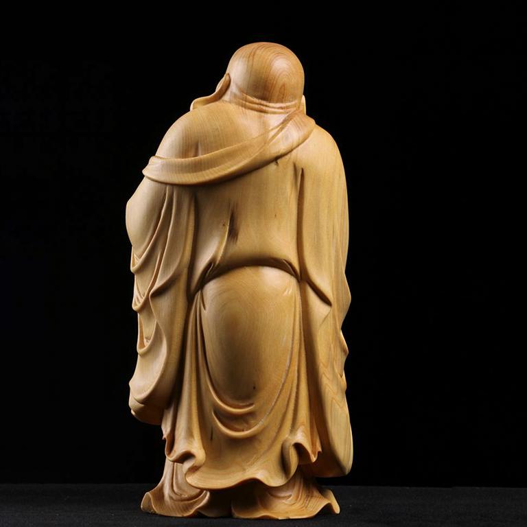 Mặt sau của sản phẩm tượng Phật Di lặc để xe ô tô bằng gỗ hoàng dương